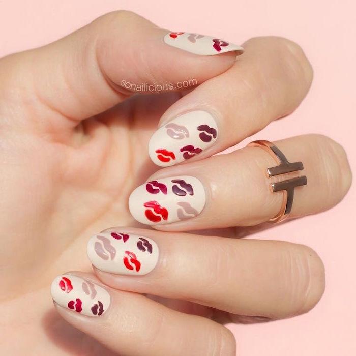 red gray and purple lips drawn on white nail polish valentines nails medium length almond nails