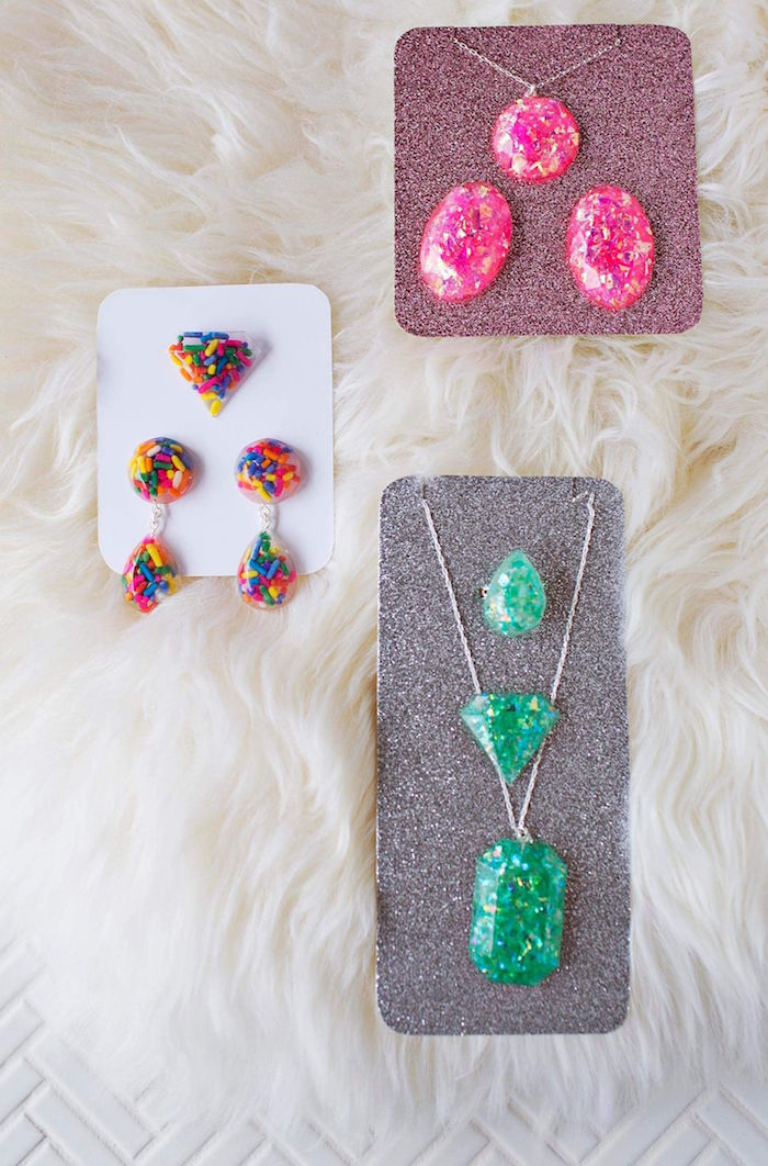 rings necklaces and earrings made of resin how to make resin jewelry pink green and colorful ones