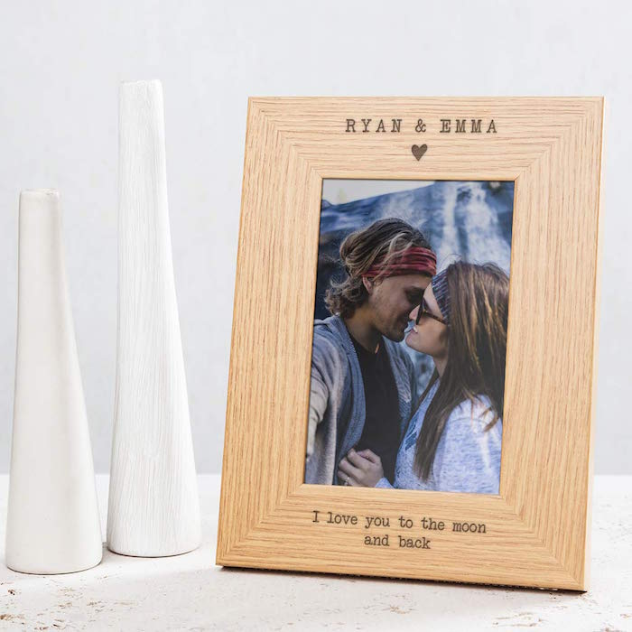 ryan and emma i love you to the moon and back engraved on wooden frame valentine's day gifts for men photo of couple kissing
