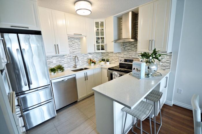 small kitchen design ideas black and white mosaic backsplash white kitchen cabinets and countertop metal bar stools