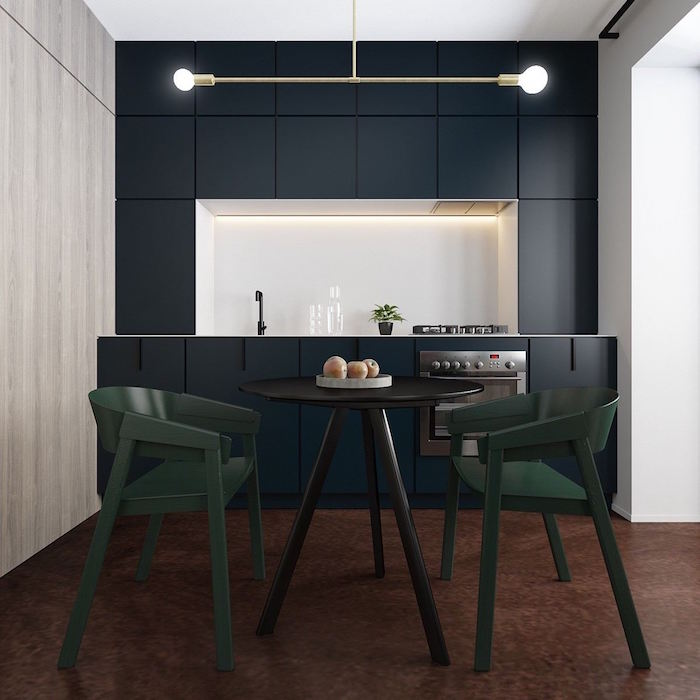 small kitchen remodel dark navy blue cabinets white backsplash with led lights wooden table with dark green chairs
