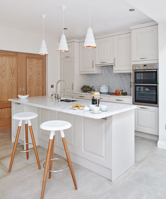 small kitchen remodel ideas white cabinets and kitchen island with marble countertops and backsplash