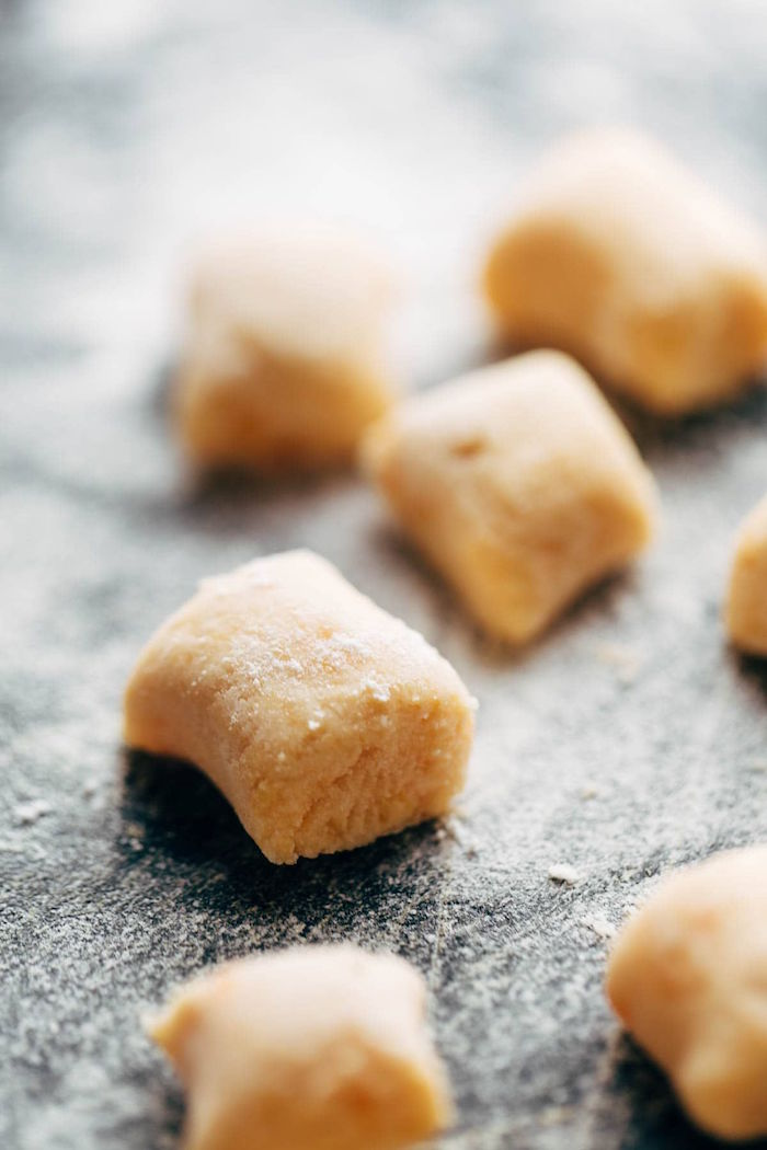 sweet potato gnocchi step by step diy tutorial recipes using gnocchi cut into cubes placed on floured surface