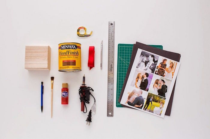 tools for step by step diy tutorial for pop up photo box valentine's day gift ideas for him arranged on white surface