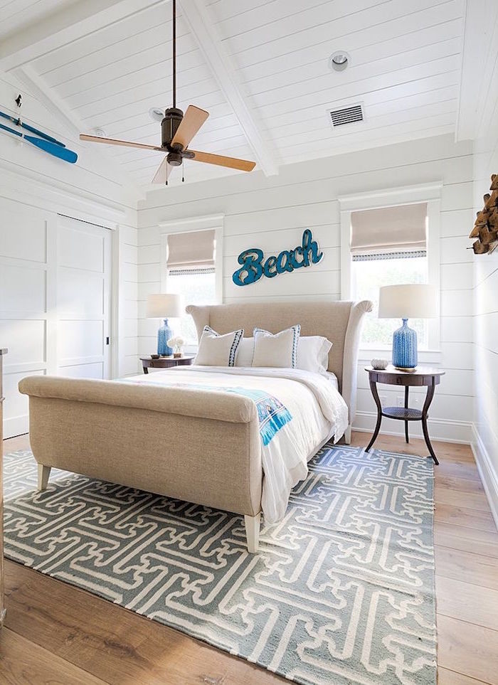 twin bed with beige bed frame beach house decor room covered with white shilap wooden floor with gray carpet