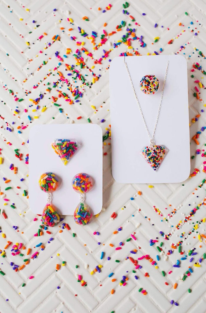 two separate sets of jewelry made with resin and colorful sprinkles resin jewelry kit earrings necklace rings