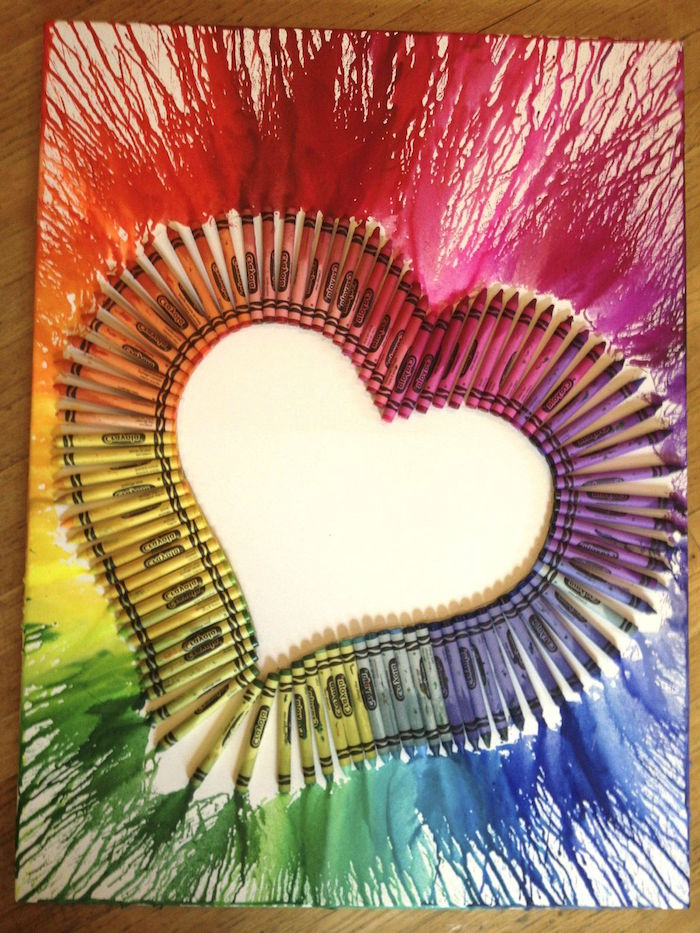 valentine gift for husband melted crayons in the colors of the rainbow in the shape of a heart outlining it