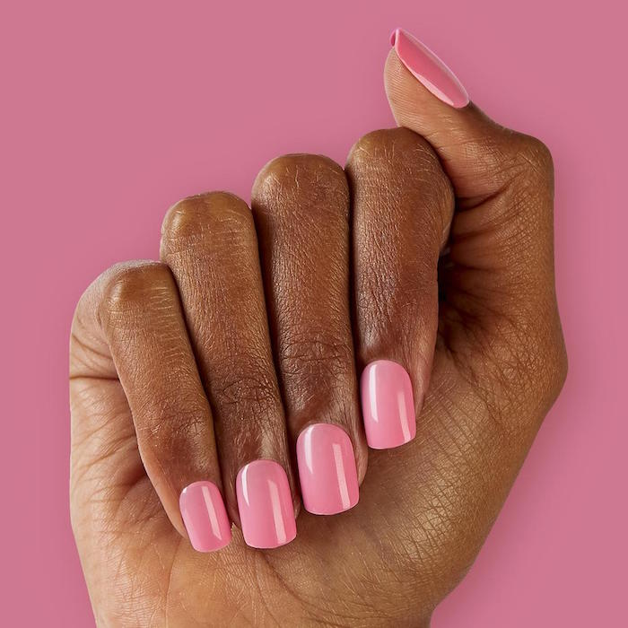valentines day nails 2021 medium length square nails covered with pink nail polish photo taken on pink background