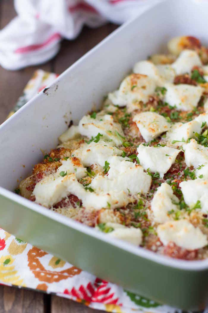 white casserole dish best gnocchi recipe baked gnocchi with ricotta cheese garnished with chopped parsley