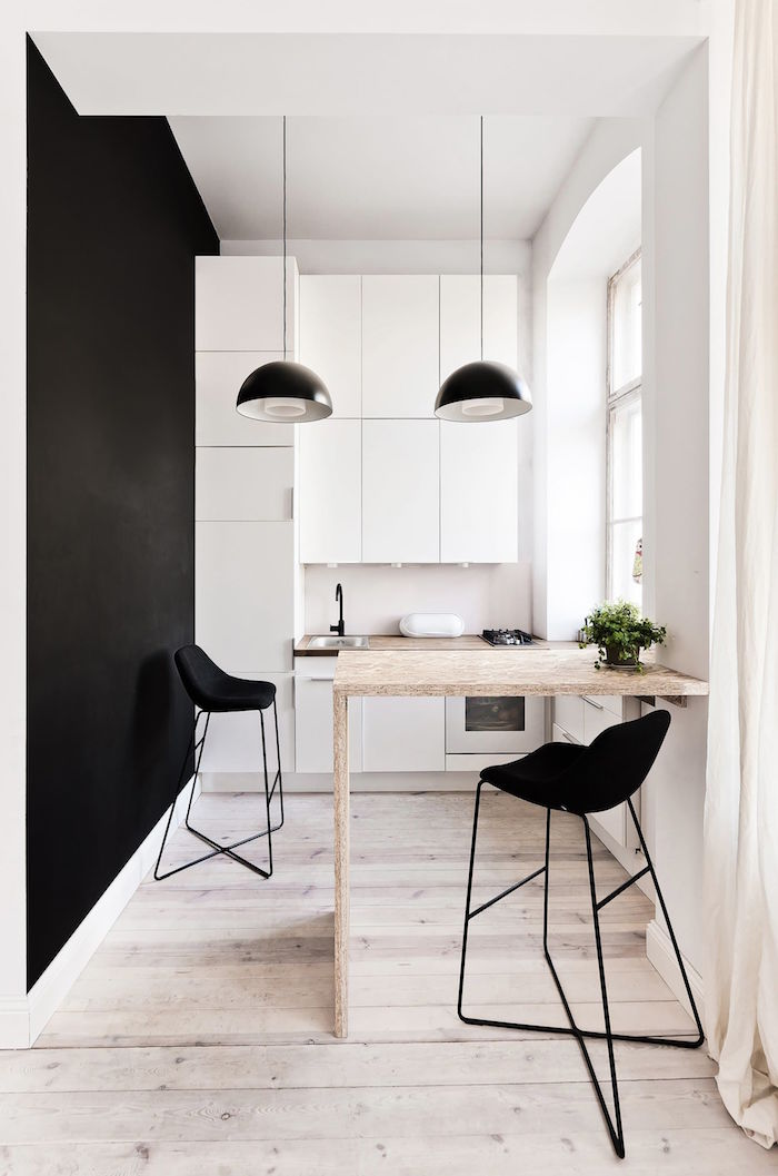 white kitchen cabinet ideas black wall wooden floor small wooden table two black metal bar stools