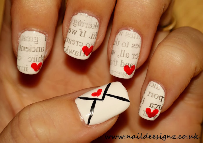 white nail polish with red hearts envelope on the thumb valentines day nails coffin shape letters decorations on each nail