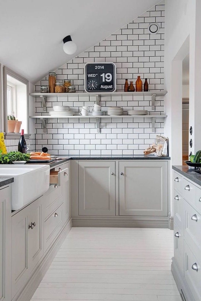 white subway tiles baacksplash open shelving white kitchen cabinets dark gray countertop small kitchen ideas rustic style