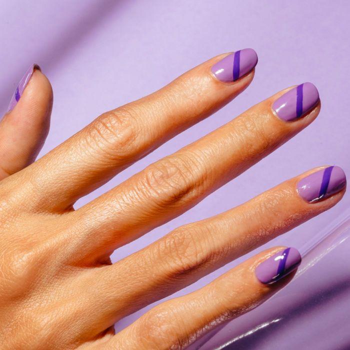 almond nail shape pretty nail designs purple nail polish with darker purple line going through the nail