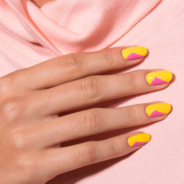 almond nails short cute nail designs yellow and pink nail polish in geometric shape