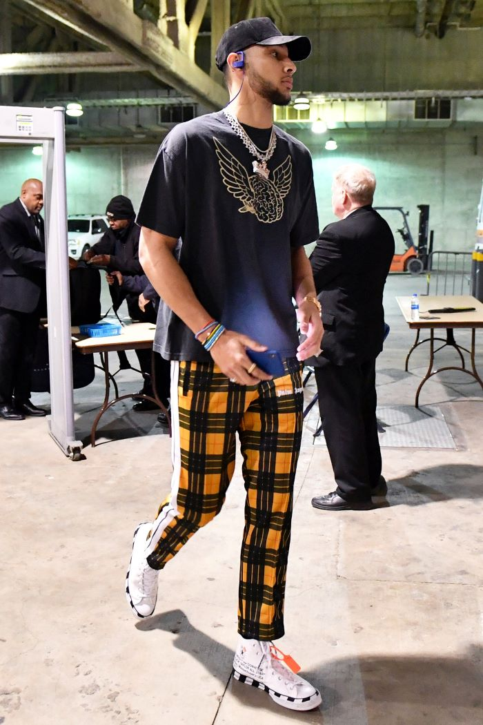 ben simmons wearing yellow and black pants black t shirt and hat hip hop clothing white sneakers