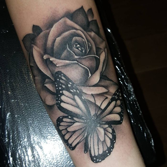 black and white forearm tattoo traditional butterfly tattoo butterfly with a rose