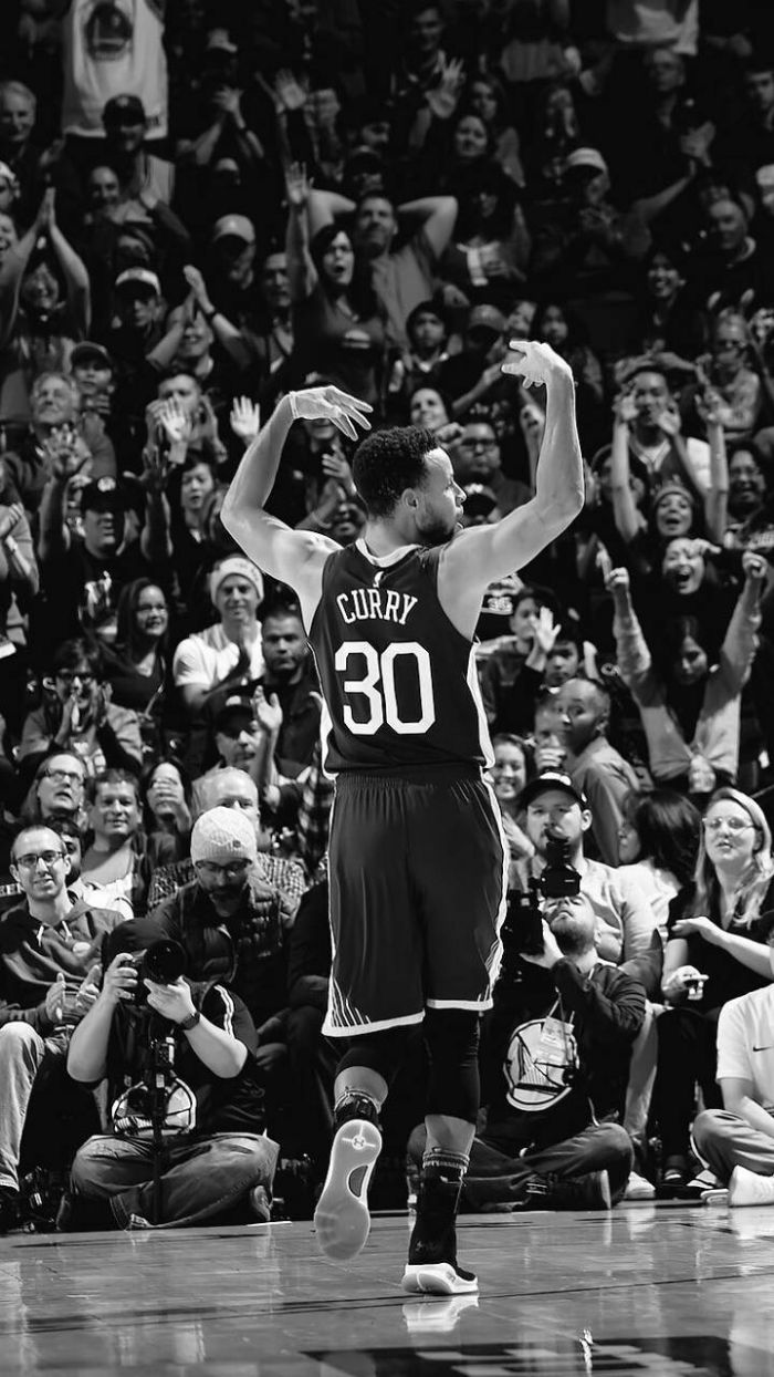 black and white photo of steph on the court hyping the crowd stephen curry wallpaper 2021