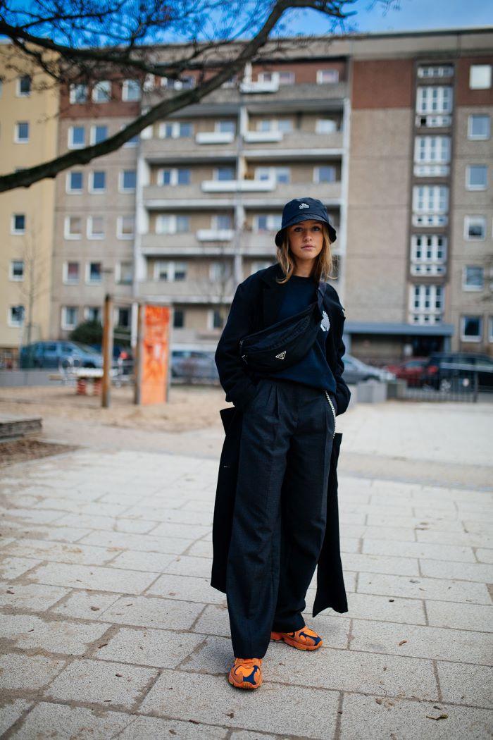 black ensemble streetwear fashion black sweatshirt long coat pants hat with orange sneakers