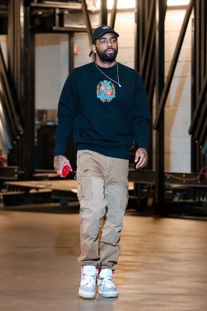 black sweater gray pants white and gray sneakers streetwear outfits worn by kyrie irving