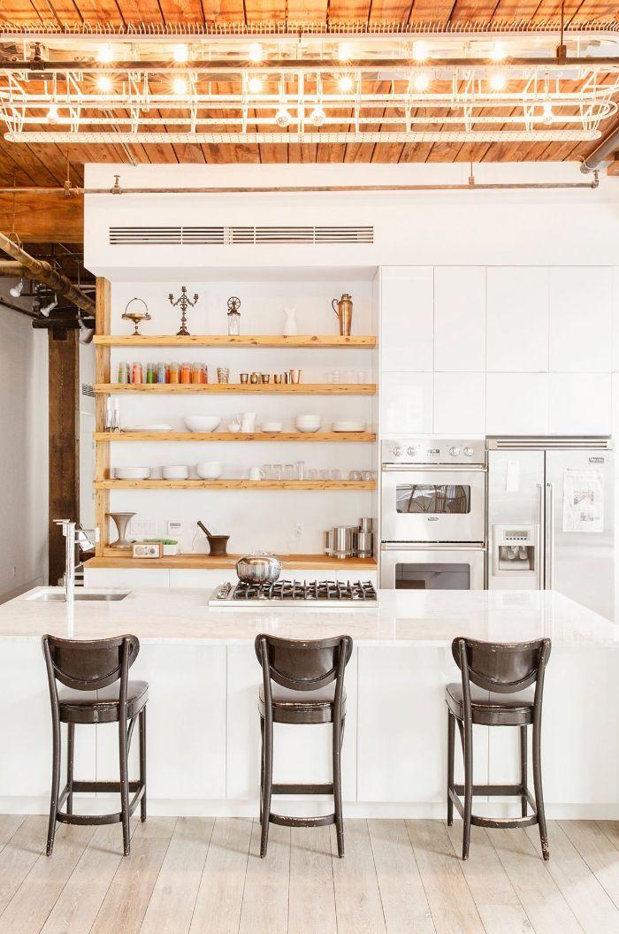 black wooden stools next to white kitchen island kitchen shelf ideas wooden with white backdrop