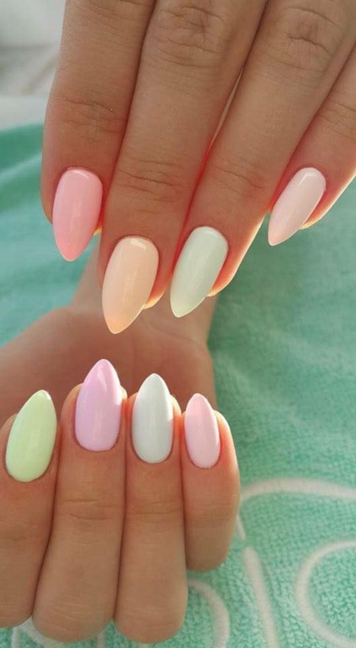 blue purple green yellow light pastel nail polish on medium length stiletto nails 2021 nail trends