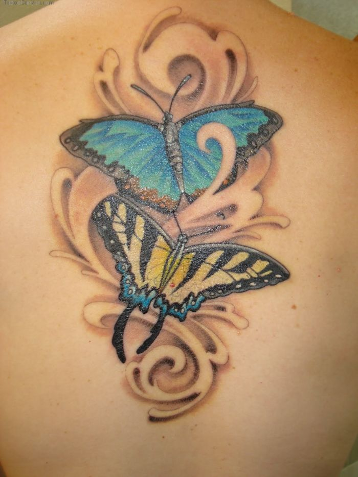 butterfly and flower tattoo two butterflies one in blue one in yellow back tattoo