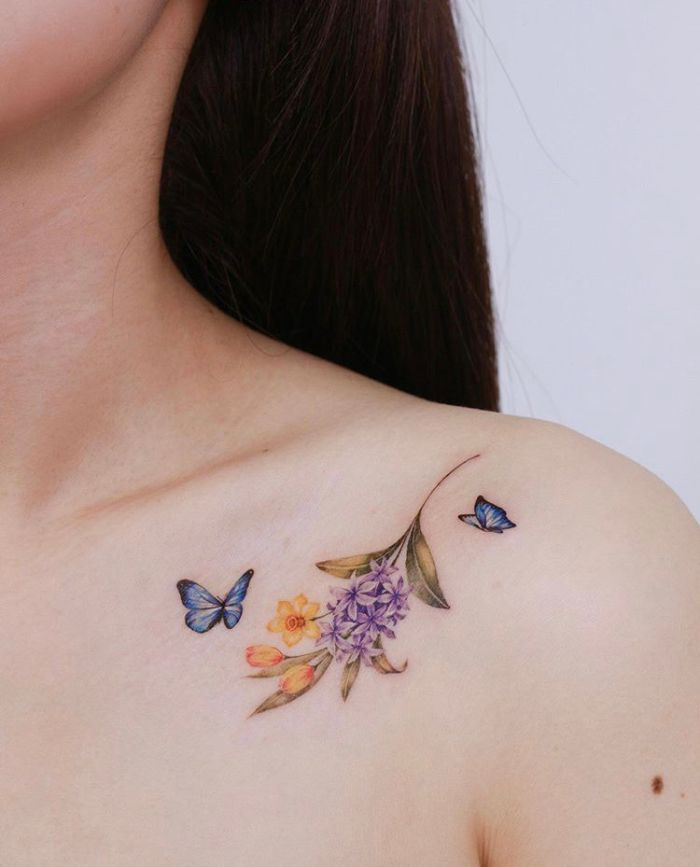 butterfly tattoo designs colored blue butterflies next to small spring flowers bouquet shoulder tattoo