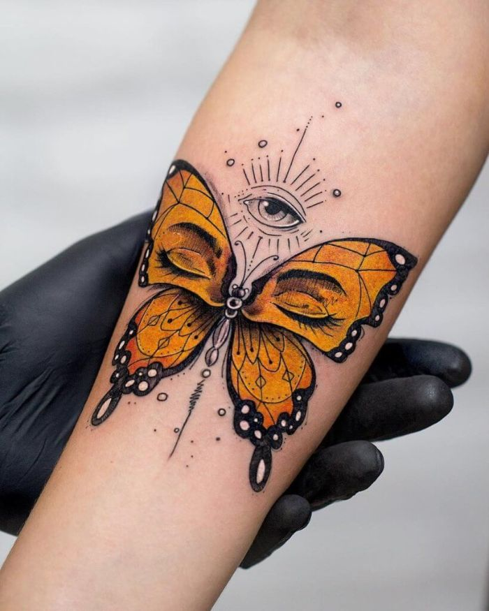 butterfly tattoo on arm orange butterfly with black outline set of eyes forearm tattoo