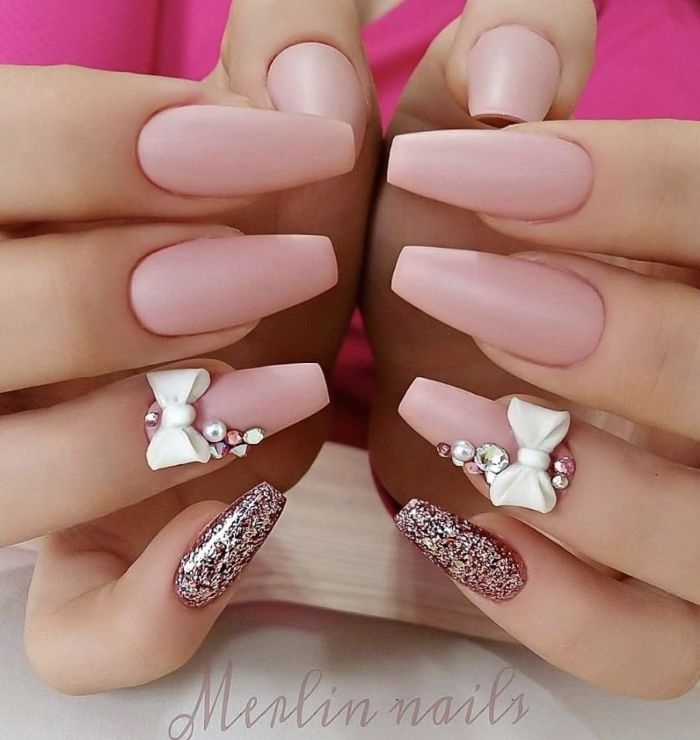 coffin nails with pink matte nail polish and pink glitter 2021 nail trends decorations with rhinestones and bows