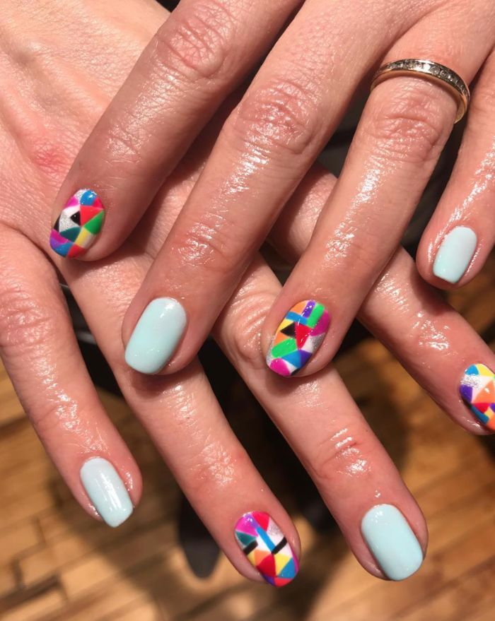 colorful geometric designs on index and ring fingers nail designs for short nails blue nail polish