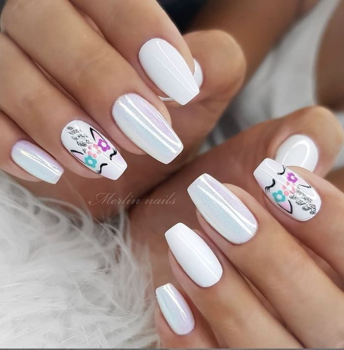 cute nail designs unicorn nails in white with unicorns drawn on ring and index fingers
