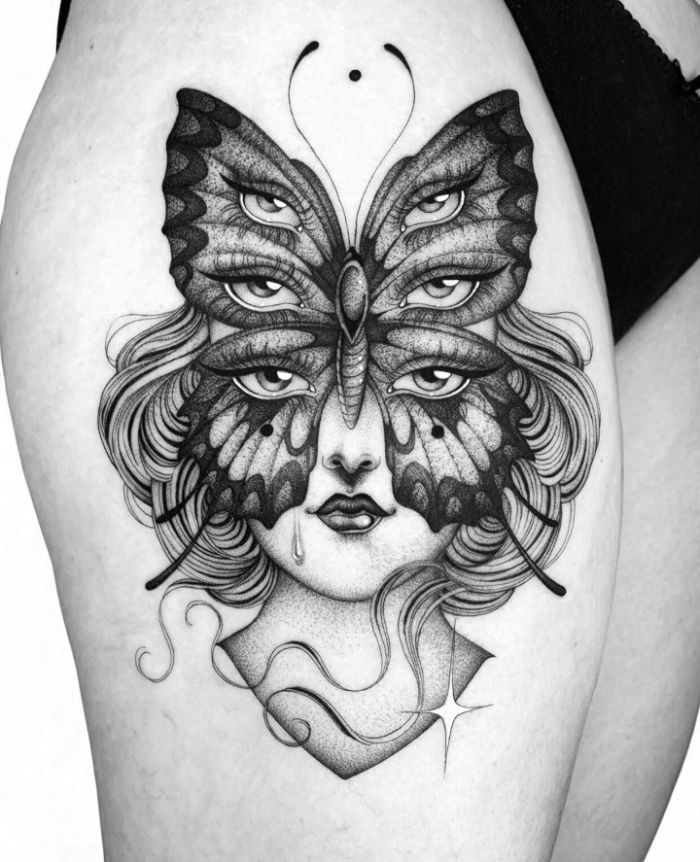 female face with large butterfly with three separate sets of eyes butterfly tattoo designs thigh tattoo