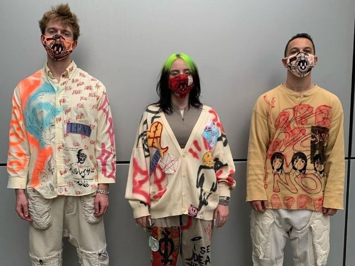 finneas billie eilish wearing oversized clothes painted with grafiti mens urban clothing