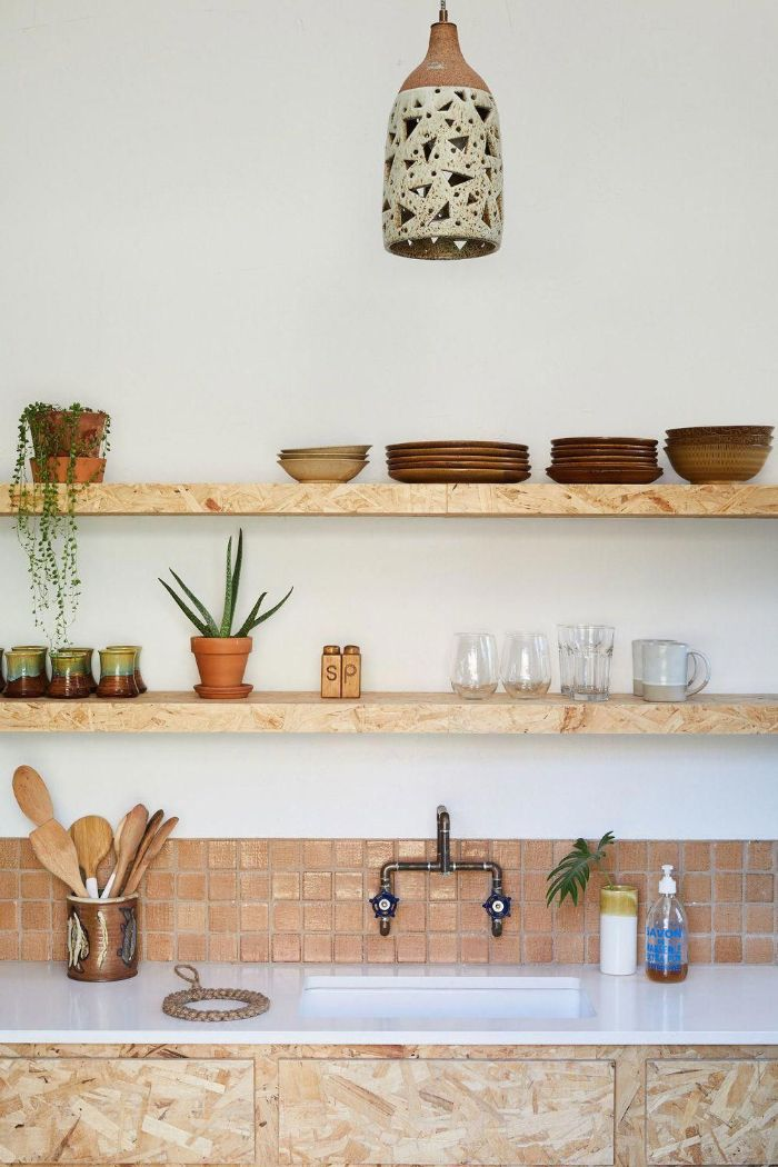 floating shelves kitchen ideas brown tiles backdrop wooden shelves with brown plates white countertop