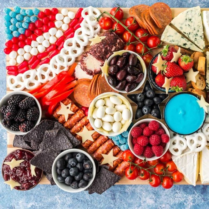 fourth of july charcuterie board cheese meats fruits and veggies swseet candy and jelly beans