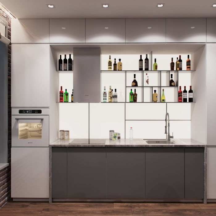 gray bottom cabinets open kitchen cabinets with different bottles of alcohol white backdrop