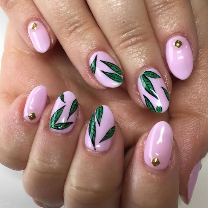 green leaves decorations on medium length almond nails flower nail designs pink nail polish with rhinestones