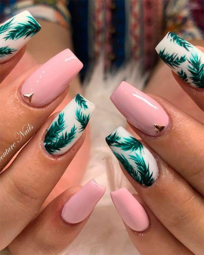 green palm leaves decorations on white nail polish base simple nail ideas pink nail polish with rhinestones