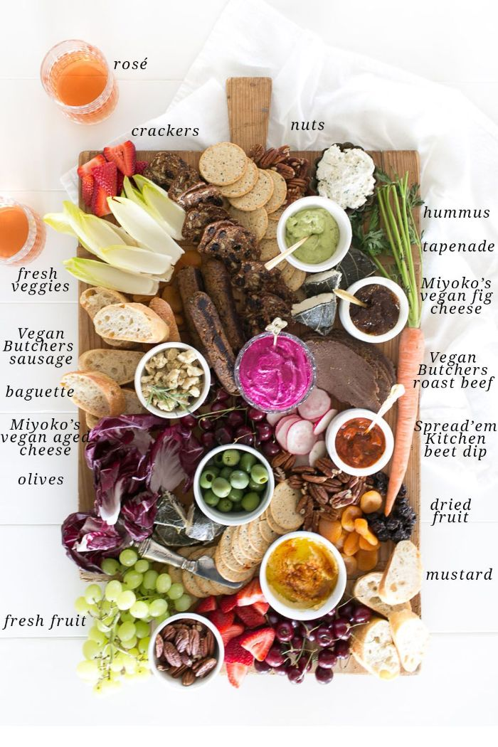 how to make a charcuterie board different types of cheese meat fruits veggies arranged on wooden board