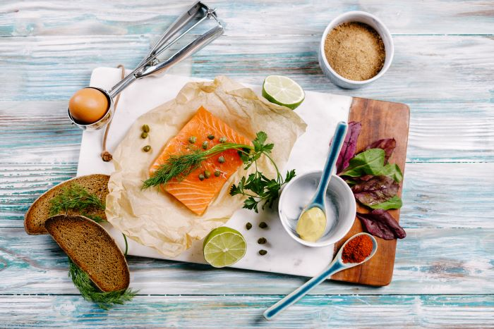 ingredients for salmon meatballs birthday party food ideas spread out on marble cutting board