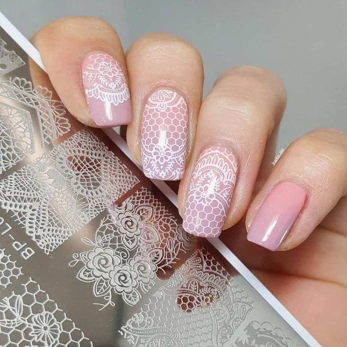 lace like white decorations on light pink nail polish spring nail colors 2021 medium length square nails