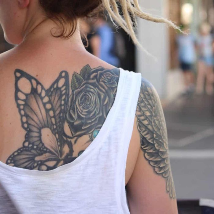 large back tattoo of butterfly with roses traditional butterfly tattoo angel wings on the arm