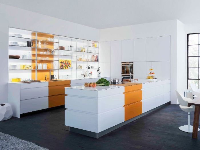 large kitchen with white cabinets and kitchen island with orange accents floating kitchen shelves