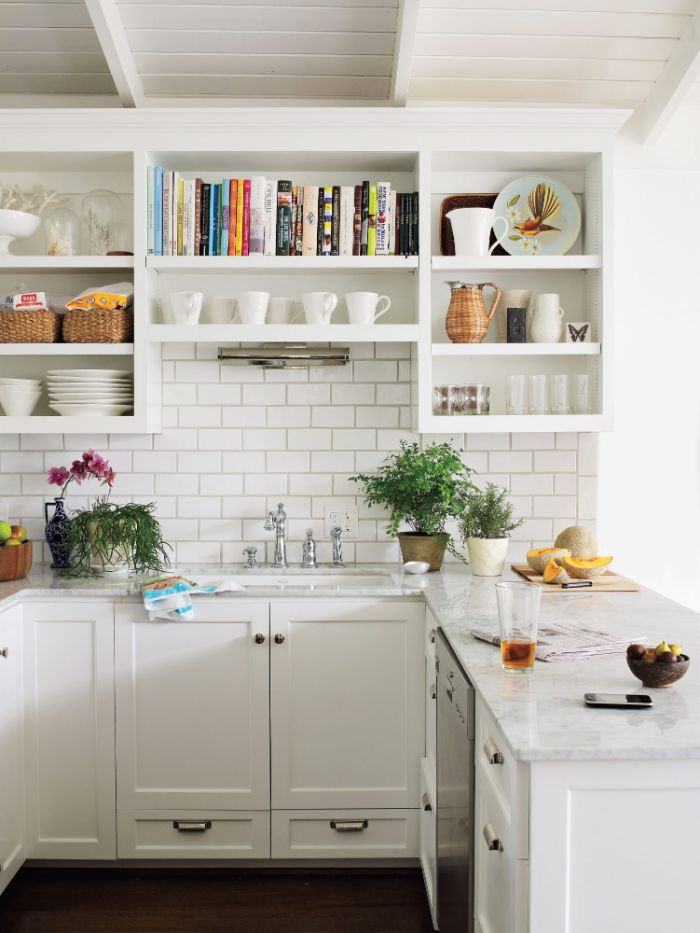 marble countertops on white cabinets kitchen with shelves instead of cabinets white subway tiles backdrop