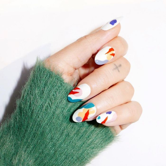medium length almond nails with white base nail designs 2021 abstract brush strokes on them in blue red orange