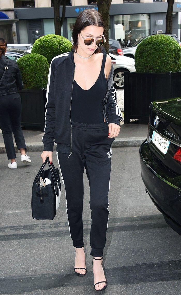mens hip hop clothing bella hadid wearing black adidas tracksuit with black top and high heels