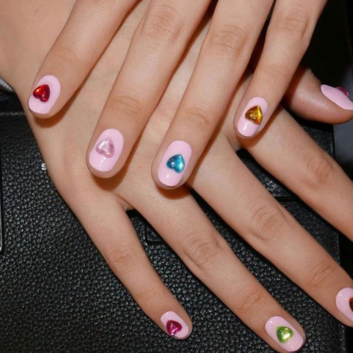 nail designs for short nails in almond shape pink nail polish base heart rhinestones different color on each finger