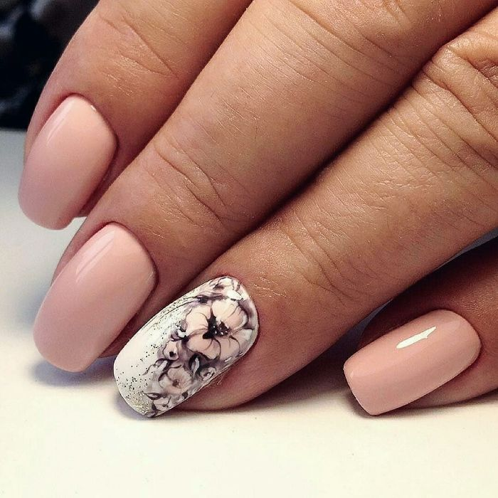 nude base on medium length squoval nails spring nail designs white base with watercolor flowers decorations on ring finger