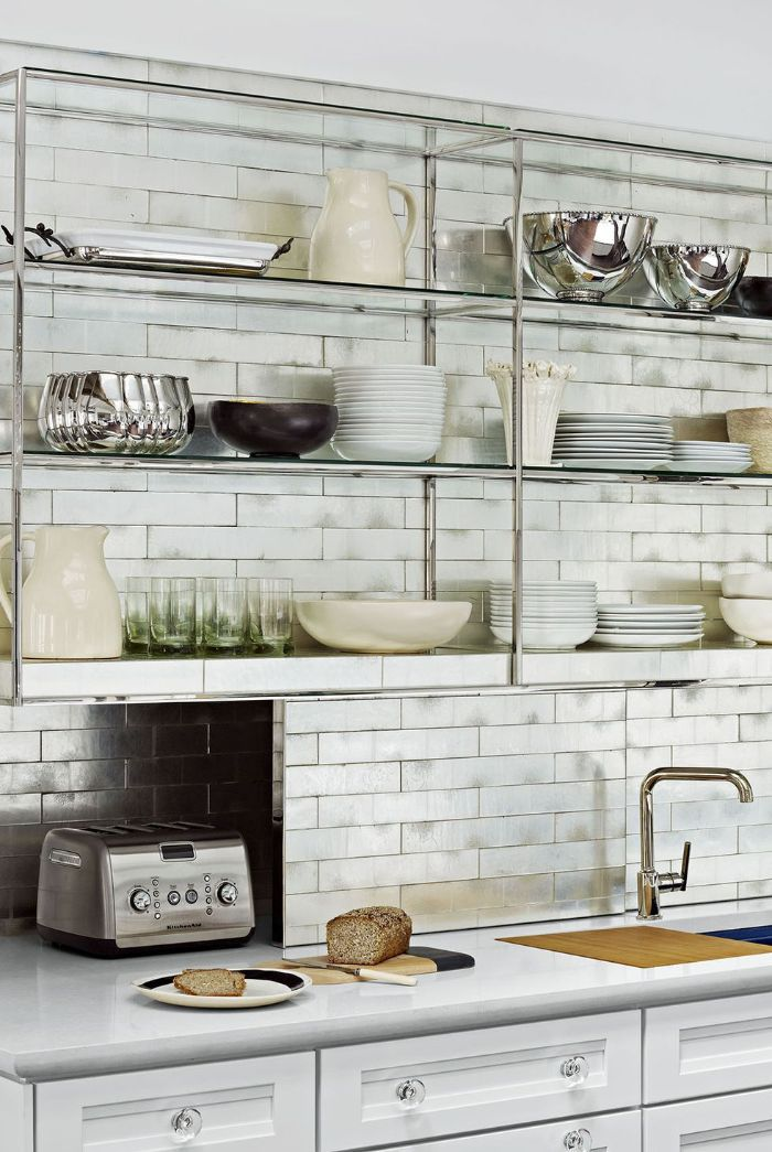 open kitchen cabinets metallic glass shelves white subway tiles backdrop above white cabinets