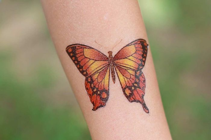 orange yellow and black butterfly traditional butterfly tattoo forearm tattoo